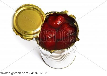 Metal Jar With Canned Strawberries Isolated On A White Background