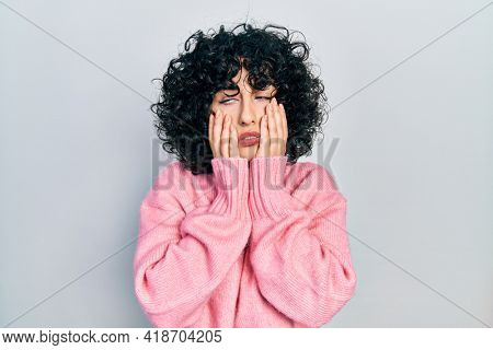 Young middle east woman wearing casual clothes tired hands covering face, depression and sadness, upset and irritated for problem