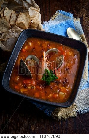 Fresh Hot Manhattan Clam Chowder Soup With Whole Head-on Shrimp
