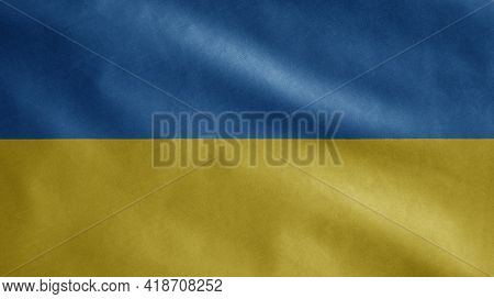 Ukrainian Flag Waving In The Wind. Close Up Of Ukraine Banner Blowing Soft Silk.