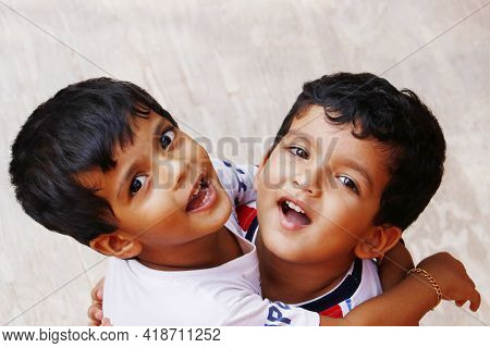 Two Indian Young Baby Boy Brothers Hugging Each Other