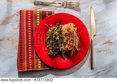 Goat Cheese Stuffed Chicken With Sundried Tomatoes And Side Of Garlicky Broccoli Rabe