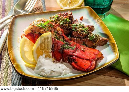Surf And Turf Lobster And Steak Tips With Tartar Sauce And Pesto