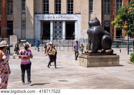 Medellin, Antioquia, Colombia - January 6 2021: Tourists Walking Near A Bronze Sculpture, A Statue O