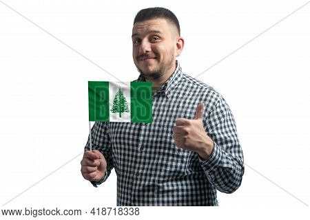 White Guy Holding A Flag Of Norfolk Island And Shows The Class By Hand Isolated On A White Backgroun