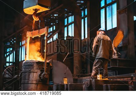Metallurgist Control Casting Metal In Foundry Workshop Factory.