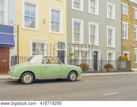 July 2020. London. Colourful Buildings And Nissan Figaro Car In Notting Hill, London, England