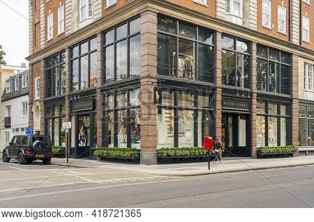 July 2020. London. Woman Walking Past Ralph Lauren Store, Fulham Road, London, England