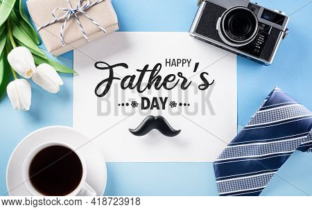 Happy Father's Day Decoration Concept With Greeting Card On Pastel Blue Background.