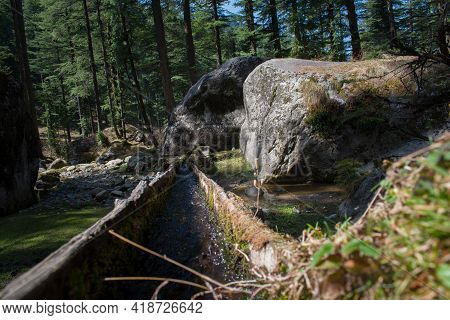 Transporting Water Through Logs Canal In Himachal Pradesh, India. Ancient Way Of Transporting Water