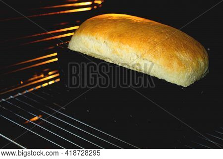 Bread In The Oven. Homemade Bread Is Baked In An Oven. Baking At Home. Bakery.