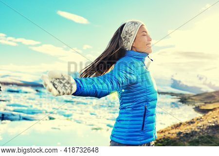 Sustainability. Sustainable travel concept. Tourist offset carbon footprintto battle climate change, global warming. Sustainable tourism. Woman on Iceland nature landscape Jokulsarlon glacial lagoon