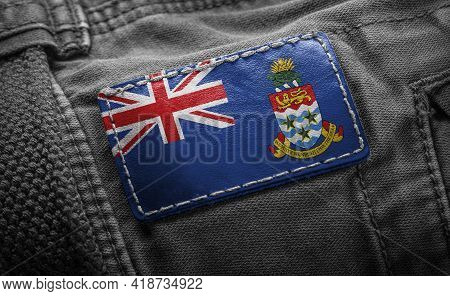 Tag On Dark Clothing In The Form Of The Flag Of The Cayman Islands