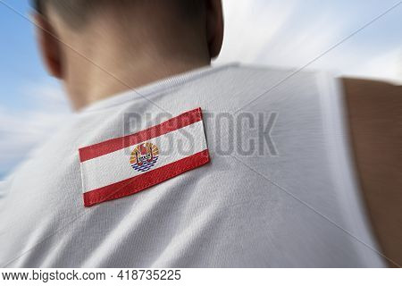The National Flag Of French Polynesia On The Athletes Back