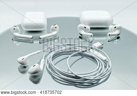 Bologna - Italy - April 27, 2021: Three Different Systems Of Apple Inc. Earphone: Air Pods And Air P