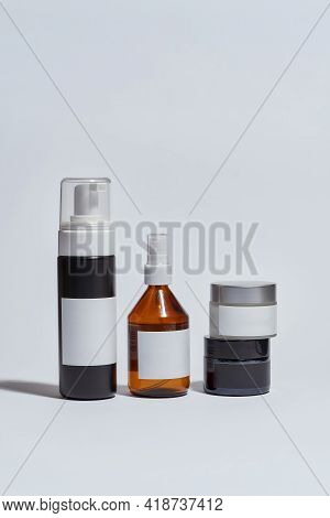 Different Types Of Cosmetological Bottles With Blank Labels On White Background, Vertical Shot. Beau