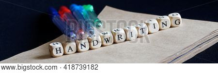 Multi-colored Ballpoint Pens Lie On A Notebook Made Of Eco-friendly Paper And The Inscriptions Handw