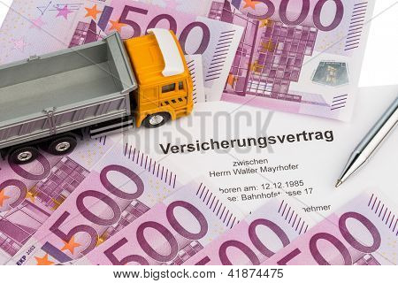 an insurance contract for new trucks. with euro money bills