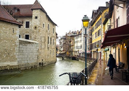 Annecy, France-april 3, 2019: The Tioux River Embankment In The Old Town, Surrounding A Medieval Pal