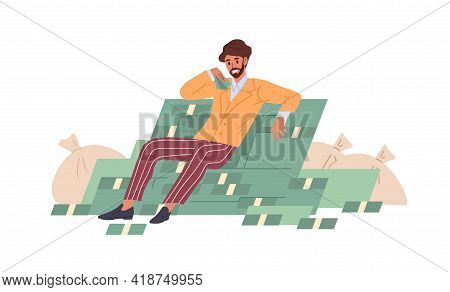 Rich Successful Businessman Sitting On Money Pile And Bags Stuffed With Cash. Young Millionaire With