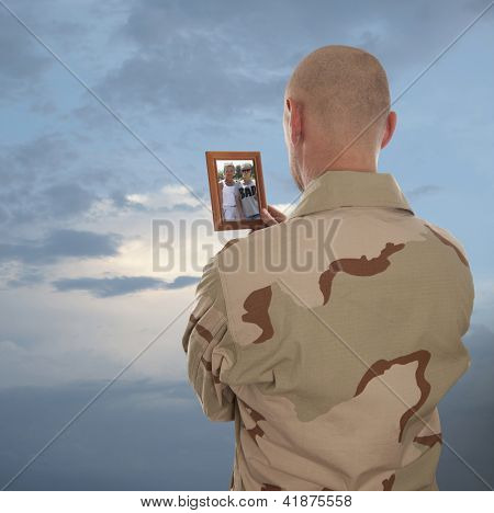 Marine looks at the picture of the family