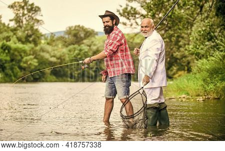 Money Attracting Ideas. Friends Men With Fishing Rod And Net. Retired Dad And Mature Bearded Son. Ha
