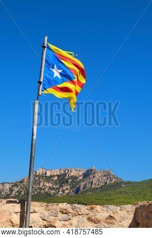 Old flag Catalunya in landscape