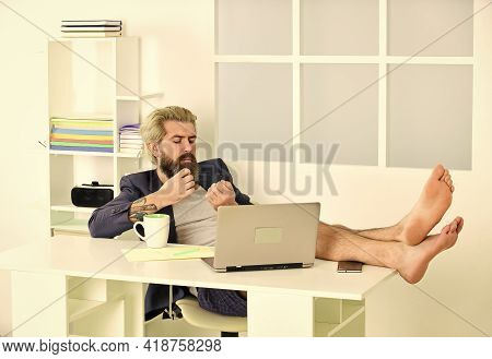 Working Barefoot At Home Office. Social Distancing Concept. Man Is Working At Home During Coronaviru