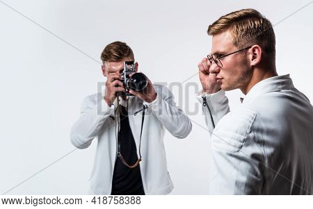 Young Twin Brothers Photographer With Similar Appearance Make Photo With Retro Camera, Photographing