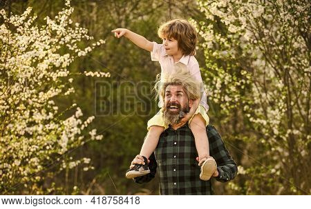 Happy Family. Little Son. Spring Walk. Fatherhood. Fathers Day. Little Boy And Father In Nature Back