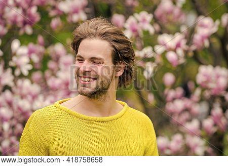 Tender Flowers. Hipster Enjoy Blossom. Springtime Concept. Guy Relax In Flowers Park. Botanical Gard