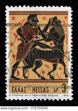 ZAGREB, CROATIA - SEPTEMBER 18, 2014: Stamp printed in Greece shows Hercules Deeds - Hercules and Centaur Nessus, circa 1970