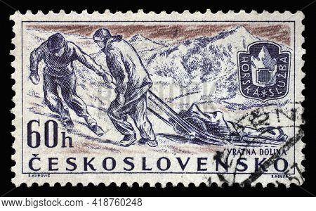 ZAGREB, CROATIA - SEPTEMBER 18, 2014: Stamp printed in Czechoslovakia shows Mountain Climbing Rescue Service, Sports 1957 series, circa 1957
