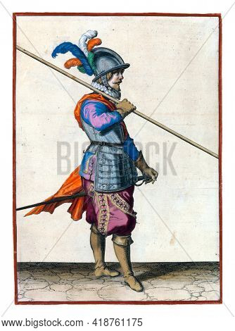 A soldier, full-length, to the right, carrying a spear (lance) on his right shoulder, the point pointing obliquely towards the ground. His right hand on the skewer