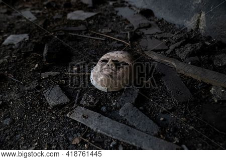 White Ceramic Mask Abandoned In A Factory That Gives A Feeling Of Abandonment