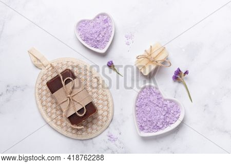 Organic Soap And Lilac Sea Salt On Marble Background. Daily Bodycare Concept, Natural Bath Products