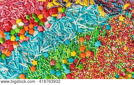 Abstract Background Of Multicolored Sugar Sprinkles Of Different Shapes For Decorating Glazed Pastri