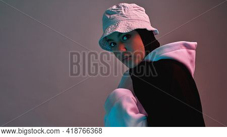 Fashionable Young Arabian Girl In Hijab And Panama Hat Posing On Light Background And Looking At Cam