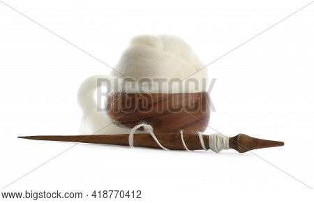 Ball Of Combed Wool With Wooden Spindle And Bowl Isolated On White