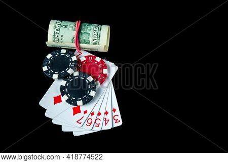 Poker Game With Straight Flush Combination And Money. Chips And Cards On The Black Table. Winnings I