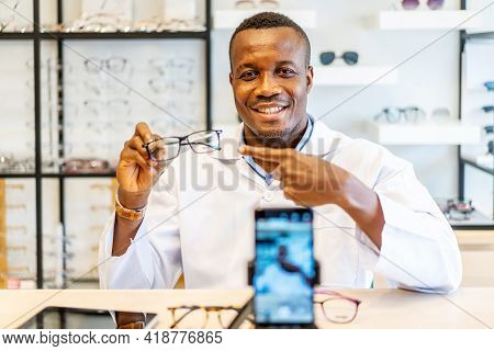 African American Attractive Optician Entrepreneur Is Vlogger Or Blogger Show Fashion Glasses To Cell