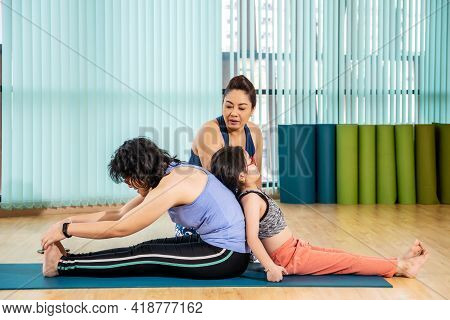 Fitness, Stretching Practice, Yoga Teacher With Student Working Out In Sports Club, Instructor Helpi