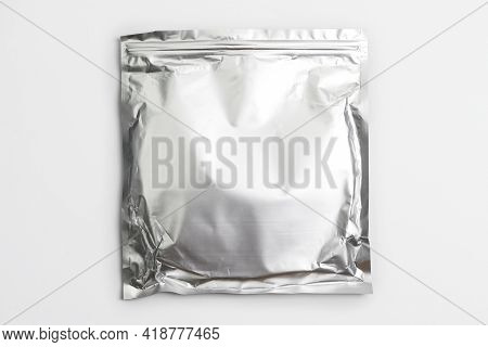 Foil Bag Package Isolated On White Background. Silver Aluminium Metallic Foil Doypack, Packaging Pou
