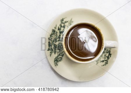 Overhead View On Serving Of Classic Retro Cup Of Coffee At Kopitiam Or Old Coffee Shop