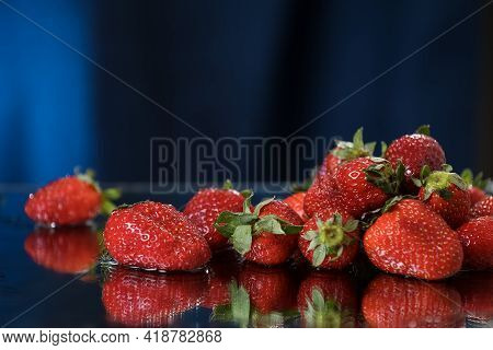 Big Red Strawberries Closeup On A Dark Blue Background. Healthy Lifestyle. Multivitamin Cocktail. Su