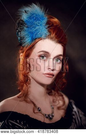 Portrait of a beautiful red-haired woman with makeup and hairdo in  Victorian style, 19th century. Vintage background.