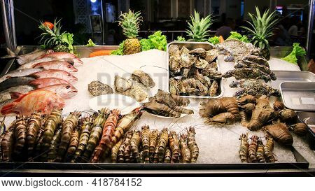 Thailand Street Seafood. Oyster, Crayfish, Crab, Fish And Shrimp On Ice Tray Ready To Cook For Touri