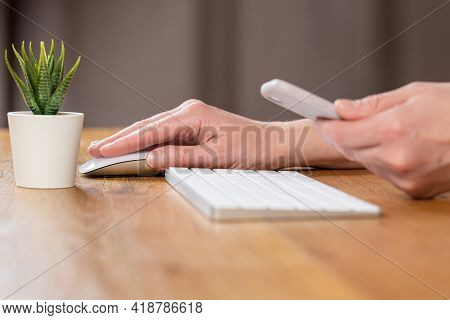 Woman Hands Close Up Working On White Computer Keyboard And Smartphone, Work From Home Concept. Work