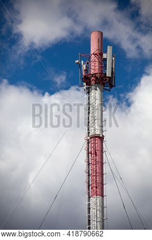 High Pipe On Which The Equipment For Cellular Communication Is Installed. Mobile Antenna. Radio Towe