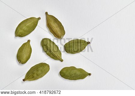 Closeup View Of Green Cardamom (elettaria Cardamomum) Pods On A White Background